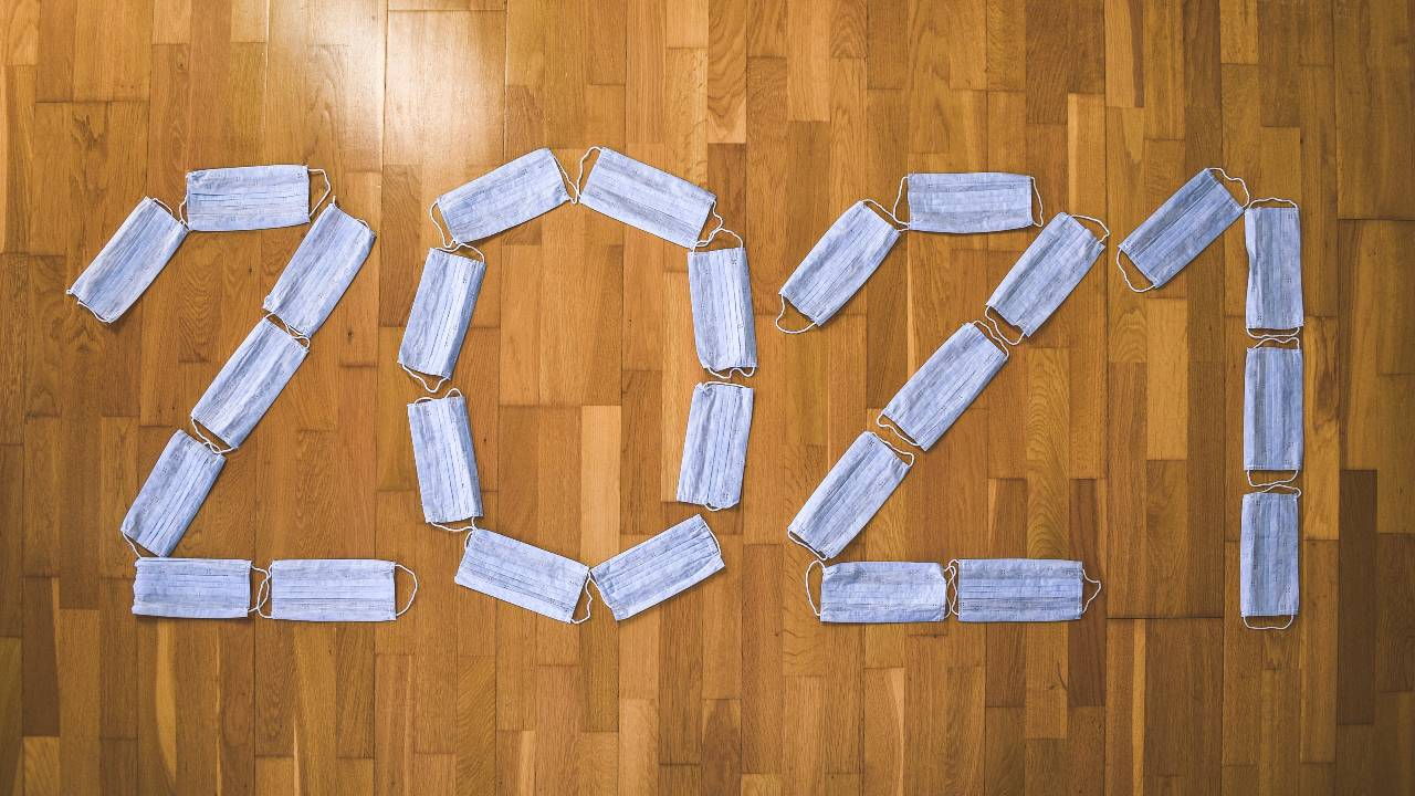 2021 spelled out with hospital marks on a hardwood floor