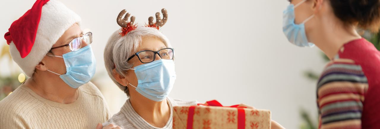 nurse receiving gifts in 2020 wearing masks